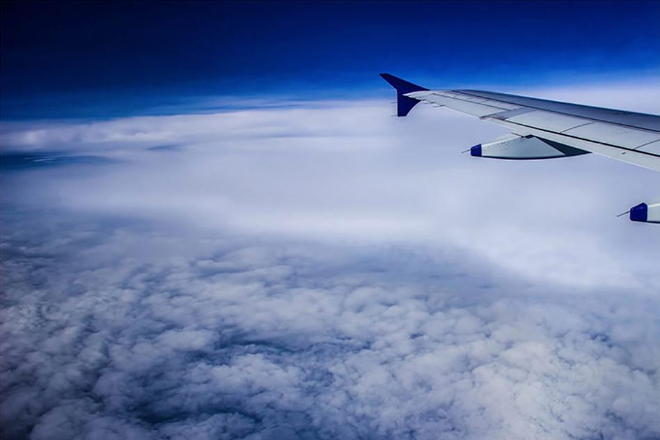 airplane-wing-flying-over-clouds-800x600_WEB.jpg
